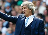 Manchester City's Chilean manager Manuel Pellegrini gestures on the touchline during the English Premier League football match between Manchester City and Stoke City at the Etihad Stadium in Manchester, north west England, on April 23, 2016. Manchester City won the game 4-0. / AFP PHOTO / LINDSEY PARNABY / RESTRICTED TO EDITORIAL USE. No use with unauthorized audio, video, data, fixture lists, club/league logos or 'live' services. Online in-match use limited to 75 images, no video emulation. No use in betting, games or single club/league/player publications.  / LINDSEY PARNABY/AFP/Getty Images