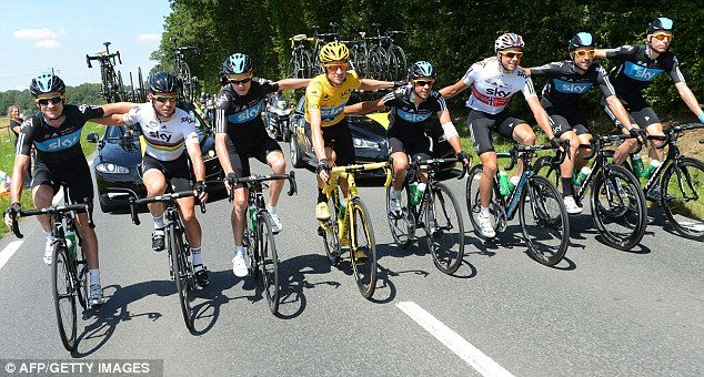 Teamwork: Bradley Wiggins in his yellow jersey with his Sky team-mates during the final stage