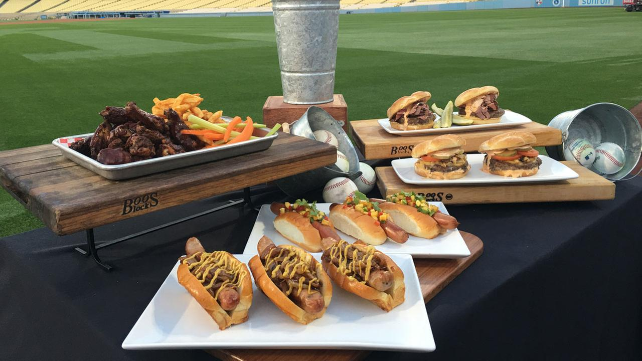 Barbecue chicken wings, Shock Top bratwurst and two gourmet hamburgers are shown on display at Dodger Stadium.