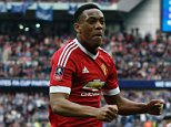 Manchester United's French striker Anthony Martial (C) celebrates scoring their second goal to take the lead 2-1 during the English FA Cup semi-final football match between Everton and Manchester United at Wembley Stadium in London on April 23, 2016. / AFP PHOTO / ADRIAN DENNIS / NOT FOR MARKETING OR ADVERTISING USE / RESTRICTED TO EDITORIAL USEADRIAN DENNIS/AFP/Getty Images