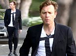 *EXCLUSIVE* Brentwood, CA - Ewan McGregor sings to himself and checks out his good looks in a car window while heading to a dinner party. Ewan keeps it simple in a black blazer, white t shirt with a black printed on tie, black pants, and black boots.    AKM-GSI      April 22, 2016 To License These Photos, Please Contact : Steve Ginsburg (310) 505-8447 (323) 423-9397 steve@akmgsi.com sales@akmgsi.com or Maria Buda (917) 242-1505 mbuda@akmgsi.com ginsburgspalyinc@gmail.com