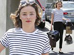 EXCLUSIVE TO INF.  April 21, 2016: Miranda Kerr looks effortless as usual and has her hands full of bags as she leaves a Skin Care Clinic in Los Angeles, California. The Australian model celebrated her 33rd birthday yesterday. Mandatory Credit: Sasha Lazic/INFphoto.com Ref: infusla-257