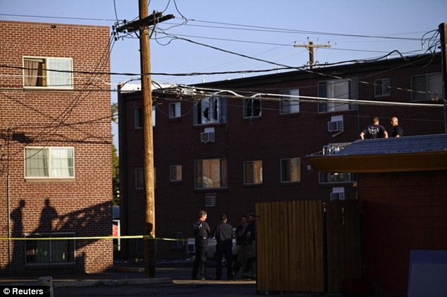 Preparation: Firefighters stand outside the apartment complex where suspect James Eagan Holmes lived in Aurora, Colorado today