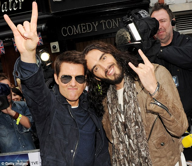 Co-stars: Actors Tom Cruise, left, is said to be hoping to convert comedian Russell Brand to scientology