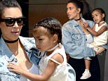 """April 24, 2016: Kim Kardashian wears a denim """"Pablo"""" jacket from her husband's merchandise line while Kourtney opts for denim shorts as the attend celebrity pastor Rich Wilkerson Jr.'s church in Miami.\nMandatory Credit: INFphoto.com Ref: infusmi-11/13"""