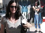 Beverly Hills, CA - Actress, Courtney Cox, pulls a juggling act as she feeds a meter while trying to hold on to her cell phone, car keys, and a pair of sneakers.\nAKM-GSI        April  25, 2016\nTo License These Photos, Please Contact :\nSteve Ginsburg\n(310) 505-8447\n(323) 423-9397\nsteve@akmgsi.com\nsales@akmgsi.com\nor\nMaria Buda\n(917) 242-1505\nmbuda@akmgsi.com\nginsburgspalyinc@gmail.com