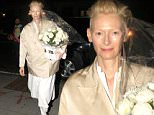Tilda Swinton and her partner Sandro Kopp seen out in New York City carrying an elegant flower bouquet.\n\nPictured: Tilda Swinton\nRef: SPL1269348  220416  \nPicture by: Said Elatab / Splash News\n\nSplash News and Pictures\nLos Angeles: 310-821-2666\nNew York: 212-619-2666\nLondon: 870-934-2666\nphotodesk@splashnews.com\n