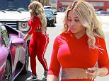 April 25, 2016: Blac Chyna shows off her tiny waist an curves in a red crop top and red pants while heading to her pink sports car in Los Angeles, CA.\nMandatory Credit: Lek/INFphoto.com Ref.: infusla-298