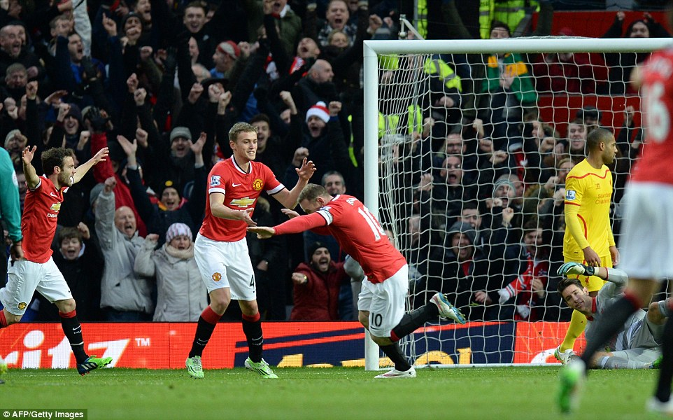 Brad Jones lays helpless on the ground (ground) while Rooney wheels away for celebrations with (from left) Juan Mata and James Wilson