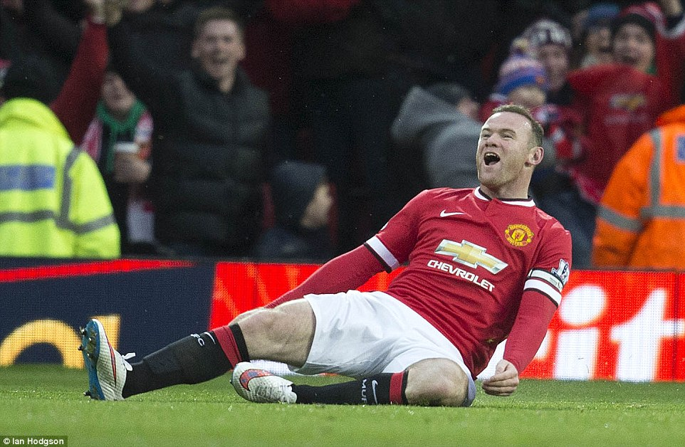 Rooney slides as he celebrates scoring the goal all Manchester United players want to score in the Premier League - one against Liverpool