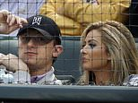 FILE - In this April 14, 2015, file photo, Cleveland Browns quarterback Johnny Manziel, left, sits with Colleen Crowley during a baseball game between the Los Angeles Angels and the Texas Rangers in Arlington, Texas. Former Cleveland Browns quarterback Johnny Manziel was indicted by a grand jury on Tuesday, April 26, 2016, on misdemeanor charges stemming from a domestic violence complaint by his ex-girlfriend. (AP Photo/LM Otero, File)