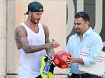 EXCLUSIVE TO INF. April 26, 2016: David Beckham puts his tattoos on display in a sweaty tank top and shorts after working out in Miami Beach, Florida. Mandatory Credit: INFphoto.com Ref: infusmi-13