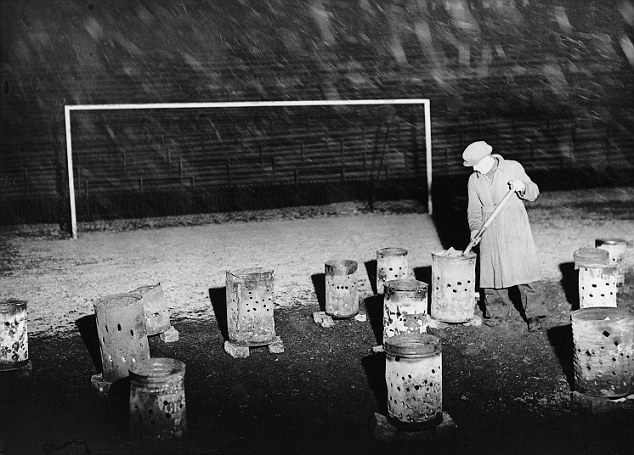 Fire 'em up: Braziers thaw out Bolton's Burnden Park in 1938