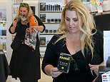 *EXCLUSIVE* Beverly Hills, CA - A hungry Ajay Rochester stocks up on Magnum Condoms and Cheetos in the 90210 at Right Aid, wearing a black dress paired with platform boots. The Aussie TV host read some of the In Touch mag while holding a large pack of condoms in her mouth before paying for her items.\n \n AKM-GSI April 26, 2016\nTo License These Photos, Please Contact :\nSteve Ginsburg\n(310) 505-8447\n(323) 423-9397\nsteve@akmgsi.com\nsales@akmgsi.com\nor\nMaria Buda\n(917) 242-1505\nmbuda@akmgsi.com\nginsburgspalyinc@gmail.com