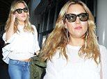 Los Angeles, CA - Kate Hudson shows off a little midriff  as she arrives for her departing flight out of LAX Airport.\nAKM-GSI         April 27, 2016\nTo License These Photos, Please Contact :\nSteve Ginsburg\n(310) 505-8447\n(323) 423-9397\nsteve@akmgsi.com\nsales@akmgsi.com\nor\nMaria Buda\n(917) 242-1505\nmbuda@akmgsi.com\nginsburgspalyinc@gmail.com