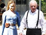 """EXCLUSIVE: Anthony Hopkins and Evan Rachel Wood film a new television show """"Westworld"""" in Los Angeles. Evan was wearing a long blue dress holding a gun during a western shootout. Evan was also smoking a cigarette during lunch break.\n\nPictured: Evan Rachel Wood\nRef: SPL1269184  260416   EXCLUSIVE\nPicture by: Ability Films / Splash News\n\nSplash News and Pictures\nLos Angeles: 310-821-2666\nNew York: 212-619-2666\nLondon: 870-934-2666\nphotodesk@splashnews.com\n"""