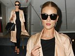 Rosie Huntington-Whiteley arrives at LAX airport in Los Angeles, CA  Pictured: Rosie Huntington-Whiteley Ref: SPL1269340  270416   Picture by: iPix211/London Entertainment  Splash News and Pictures Los Angeles: 310-821-2666 New York: 212-619-2666 London: 870-934-2666 photodesk@splashnews.com