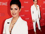 Actress Priyanka Chopra poses for photographers on the red carpet as she arrives for the TIME 100 Gala in Manhattan, New York, April 26, 2016. REUTERS/Shannon Stapleton