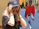 *EXCLUSIVE* Vancouver, BC - With all the Beyonce controversy, Rita Ora tries to go incognito arriving back into Vancouver, Canada so she can get back to work on 'Fifty Shades Freed' for Wednesday am. Rita covered up because she had no makeup on, but later laughed it off and had fun rolling the luggage.    AKM-GSI        April 26, 2016 To License These Photos, Please Contact : Steve Ginsburg (310) 505-8447 (323) 423-9397 steve@akmgsi.com sales@akmgsi.com or Maria Buda (917) 242-1505 mbuda@akmgsi.com ginsburgspalyinc@gmail.com