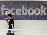 FILE - In this March 15, 2013, file photo, a Facebook employee walks past a sign at Facebook headquarters in Menlo Park, Calif. Facebook reports financial results on Wednesday, April 27, 2016. (AP Photo/Jeff Chiu, File)