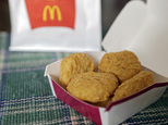 FILE - In this March 4, 2015 file photo, an order of McDonald's Chicken McNuggets is displayed for a photo in Olmsted Falls, Ohio. McDonald¿s is testing Chicken McNuggets with no artificial preservatives as it works to revive its U.S. business. The world¿s biggest hamburger chain says it began testing the new recipe in about 140 stores in Oregon and Washington in March 2016.  (AP Photo/Mark Duncan)