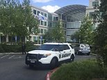 A Santa Clara county Sheriff's Office vehicle is shown parked outside one of the main office buildings of the Apple campus in Cupertino, California, April 27, 2016.  An Apple employee was found dead on Wednesday, according to police, and local media was reporting that the victim had suffered a head wound and a gun discovered near his body.  REUTERS/Julie Love
