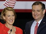 Republican presidential candidate Sen. Ted Cruz, R-Texas, joined by former Hewlett-Packard CEO Carly Fiorina waves during a rally in Indianapolis, Wednesday, April 27, 2016, when Cruz announced he has tapped Fiorina to serve as his running mate. (AP Photo/Michael Conroy)