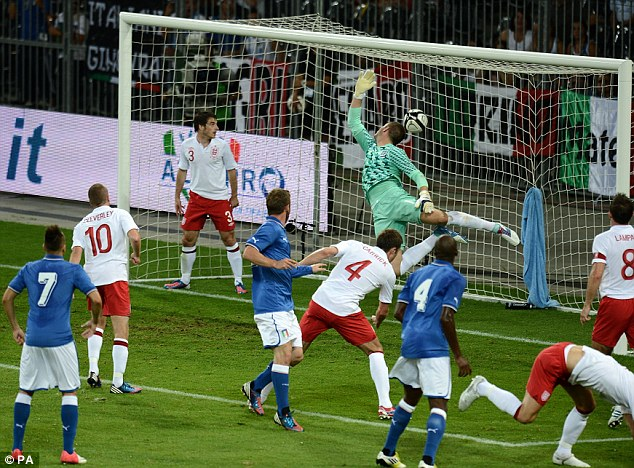 In a flap: Italy go ahead as Daniele De Rossi (fourth left) heads in