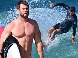 BYRON BAY, NSW - APRIL 28:  Chris Hemsworth is seen surfing and relaxing at the beach on April 28, 2016 in Byron Bay, Australia.  (Photo by Matrix/GC Images)