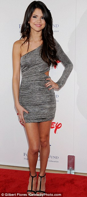 Smiles: Across town, the show also went on for Bieber's girlfriend Selena Gomez, who is surely also rocked by the claims