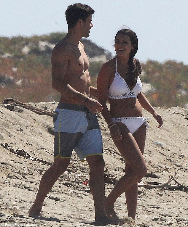 Eye candy: The reality TV star's male companion displayed his chiseled body in a pair of swim trunks