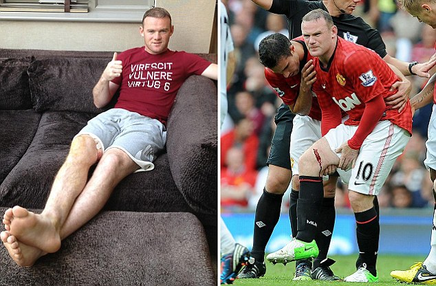 Thumbs up: Wayne Rooney is confident he can return to action earlier than expected after sustaining a nasty leg wound against Fulham