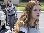 """EXCLUSIVE: Bella Thorne has her hands full as she arrives on set of the film """"You Get Me"""" wearing no makeup while still eating her breakfast from Manhattan Bagel in Los Angeles on Friday. The Disney star has been working non-stop for the last couple of weeks.\n\nPictured: Bella Thorne has her hands full arriving on set wearing No Makeup \nRef: SPL1270838  290416   EXCLUSIVE\nPicture by: REELPIX/Splash News\n\nSplash News and Pictures\nLos Angeles: 310-821-2666\nNew York: 212-619-2666\nLondon: 870-934-2666\nphotodesk@splashnews.com\n"""