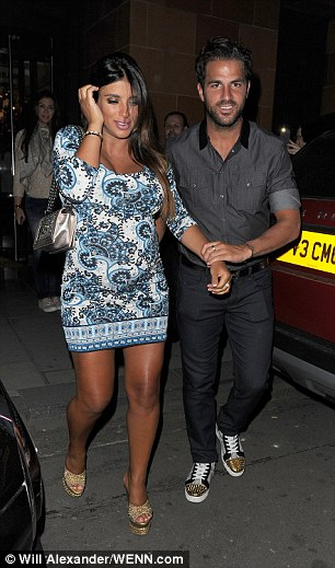 Fabregas is all smiles as he helps his heavily pregnant girlfriend to a taxi following their meal
