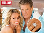 Embargoed to 0001 Tuesday May 3 THIS PICTURE MUST ONLY BE USED IN CONJUNCTION WITH THE FRONT COVER OF THIS WEEKS HELLO! MAGAZINE. NO SALES NO ARCHIVE. EDITORIAL USE ONLY. ONE USE ONLY. Undated handout photo issued by Hello! of Baywatch actor David Hasselhoff, who is engaged to his Welsh girlfriend Hayley Roberts. PRESS ASSOCIATION Photo. Issue date: Tuesday May 3, 2016. The 63-year-old revealed he asked Roberts, 36, to marry him with a romantic proposal during a beachside picnic in Malibu. See PA story SHOWBIZ Hasselhoff. Photo credit should read: Hello! Magazine/PA Wire NOTE TO EDITORS: This handout photo may only be used in for editorial reporting purposes for the contemporaneous illustration of events, things or the people in the image or facts mentioned in the caption. Reuse of the picture may require further permission from the copyright holder.