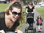 MUST BYLINE: EROTEME.CO.UK\nImogen Thomas is the picture of happiness as she spends a sunny day in the park with her two daughters as it emerges that her former lover Ryan Giggs has split from his wife.\nEXCLUSIVE  May 1, 2016\nJob: 160501L2   London, England \nEROTEME.CO.UK\n44 207 431 1598\nRef: 341629\n