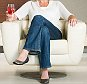 Portrait of middle aged woman sitting on chair with glass of wine