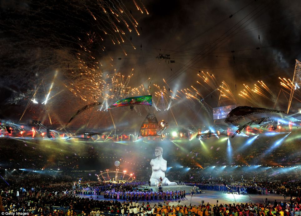 Hive of activity: Fireworks light up the stadium as a large scale reproduction of Marc Quinns celebrated sculpture Alison Lapper Pregnant emerges