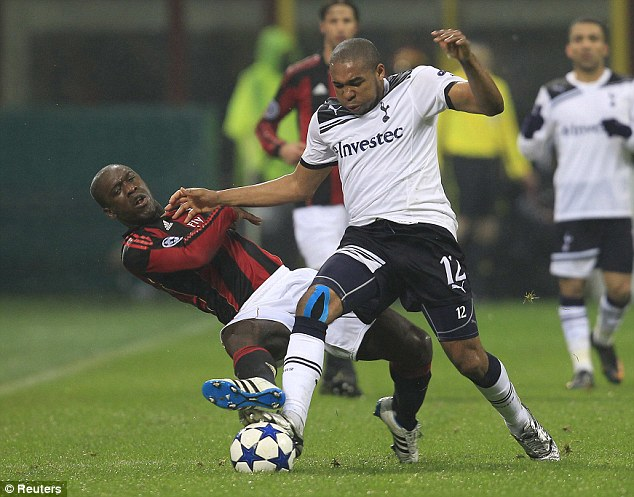No holds barred: A tussle between Wilson Palacios (right) and Clarence Seedorf typified a physical game