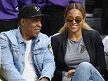 LOS ANGELES, CA - FEBRUARY 29:  Jay-Z (L) and Beyonce attend a basketball game between the Brooklyn Nets and the Los Angeles Clippers at Staples Center on February 29, 2016 in Los Angeles, California.  (Photo by Noel Vasquez/GC Images)