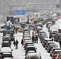Sorry sight: The M25 came to a standstill with the onset of snow - proving that Britain still finds it hard to cope with the extremes