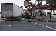 Multiple people hospitalized after big rig slams into South LA burger joint