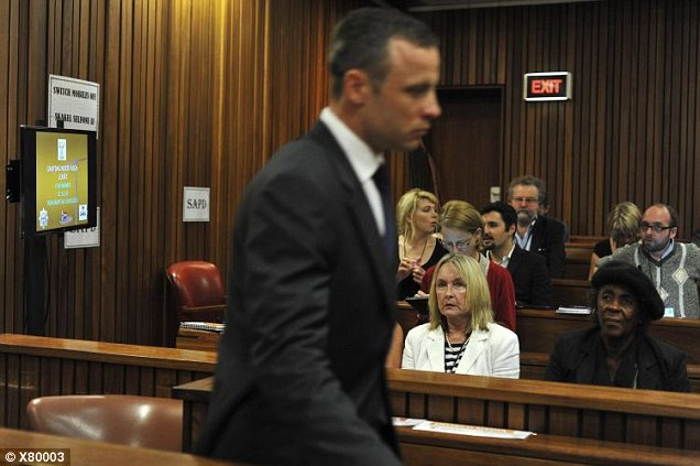 The Paralympic track star walks past June Steenkamp mother of Reeva Steenkamp, as he makes his way to the dock in the North Gauteng High Court in Pretoria