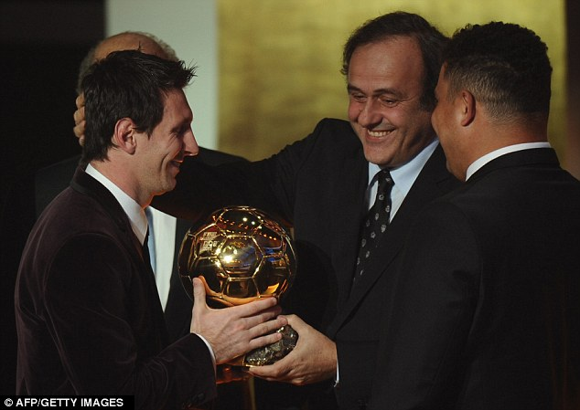 Past and present: Messi is congratulated by former winners Michel Platini and Ronaldo