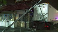 2 Seriously Injured After Big Rig Crashes Into South L.A. Burger Restaurant
