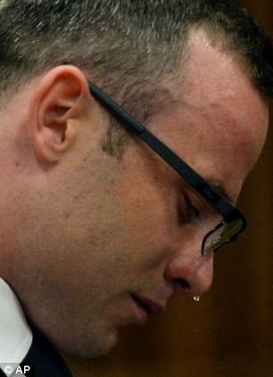 Oscar Pistorius, cries in court as he listens to evidence being given
