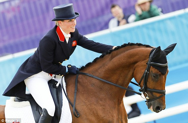 Zara Phillips comforts High Kingdom during the dressage stage of the competition