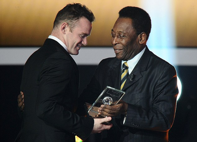 The good and the great: Wayne Rooney receives the FIFA/FIFPro World XI award from Brazilian legend Pele