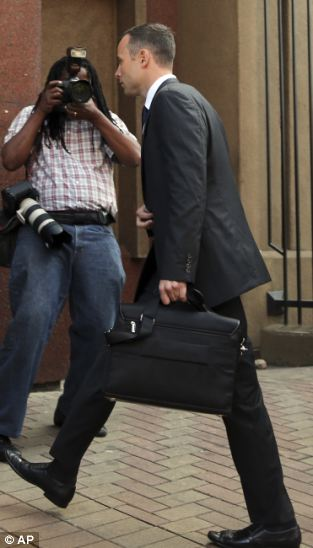 Oscar Pistorius, arrives at the high court in Pretoria, South Africa, Monday, March 24, 2014. The murder trial of Pistorius, who is charged with murder for the shooting death of his girlfriend, Reeva Steenkamp on Valentines Day in 2013, is beginning its fourth week. The prosecution has said it will wrap up its case against the double-amputee runner this week after calling four or five more witnesses, beginning Monday. The defense will then present its case. (AP Photo/Themba Hadebe, Pool)