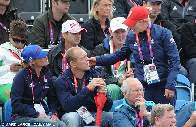 Supporting the team: Zara Phillips and husband Mike Tindall watch teammate William Fox-Pitt compete in the dressage phase of the three day event